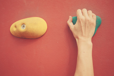 bouldering: A woman is bouldering