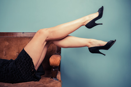 The legs of asexy young woman lying on a sofa photo