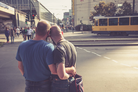 east berlin: BERLIN, GERMANY - OCTOBER 3. Homosexual couple waiting to cross the road in East Berlin on October 3, 2014 in Berlin, Germany
