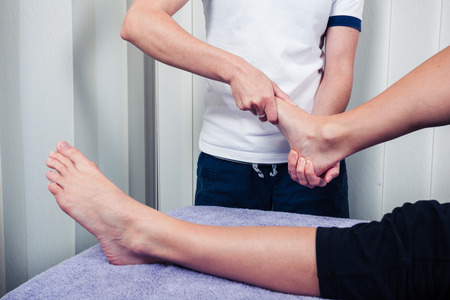 physical test: A physiotherapist is treating a patients foot Stock Photo
