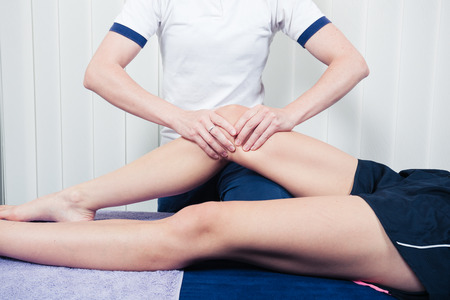 A physiotherapist is treating a patients knee