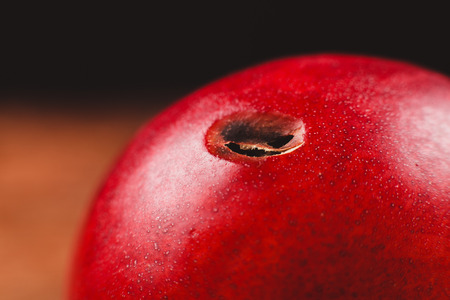inchworm: A red nectarine with a hole from a worm in it