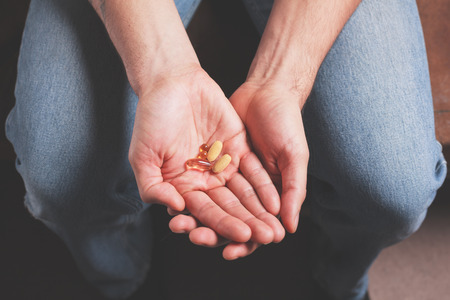 pills in hand: A male hand with pills