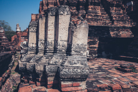 Ancient ruins of Buddhist temples at Wat Mahathat in Thailand photo