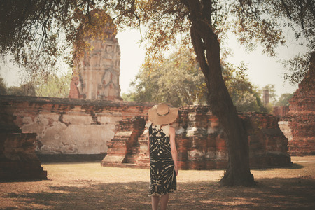 archeologist: A young woman is exploring the ancient ruins of a buddhist temple city