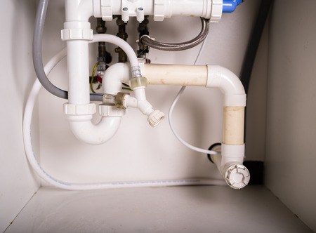 Piepes and plumbing under a kitchen sink