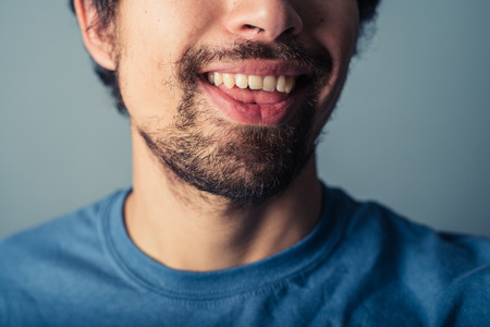 silly: A young man with a beard is pulling silly faces Stock Photo