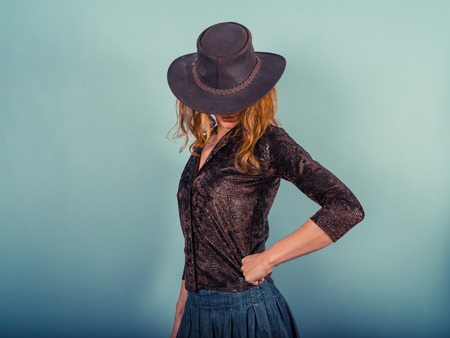 sexy cowboy: A young woman is posing and wearing a cowboy hat