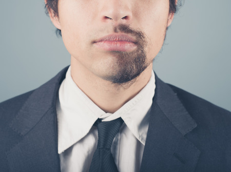 two faced: A young businessman with a half shaved beard
