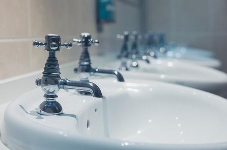 basins: A row of wash basins in a bathroom