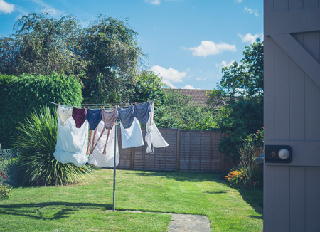 Laundry drying in a garden on a sunny summer day Stockfoto