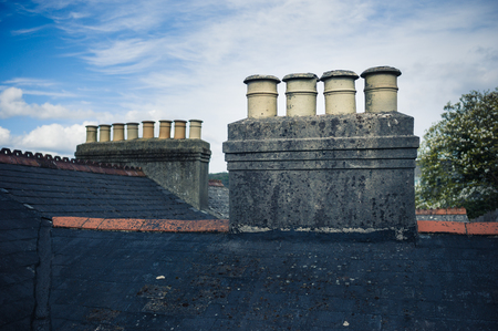 wonky: Chimney stacks on the roof of a Victorian terrace