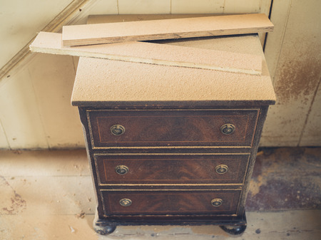 drawers: A chest of drawers covered in sawdust Stock Photo