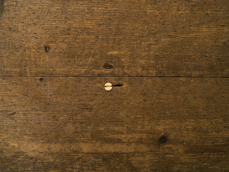 floorboards: Wooden floorboards with a single screw