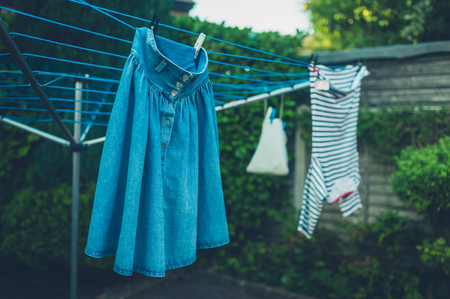 Laundry drying outside in the garden on a rack