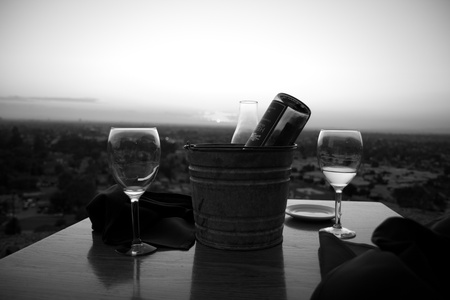 Wine bottle and glasses for a romantic dinner and a landscape view photo