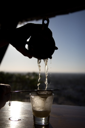 Bartender pours a drink in a picturesque silhouette