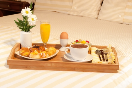full breakfast with chocolate in the bedroom photo