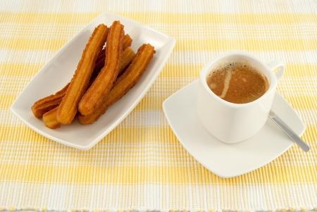 Typical Spanish breakfast cafe con leche churro com Stock Photo