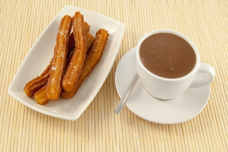 churros: Typical Spanish breakfast chocolate with churros Stock Photo