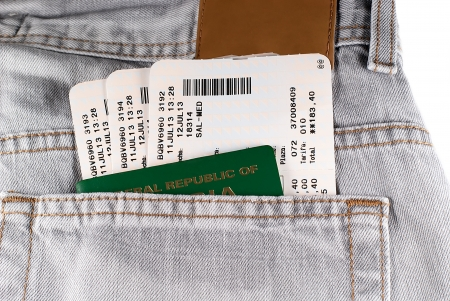 a passport in the pocket of the jeans with plane tickets photo