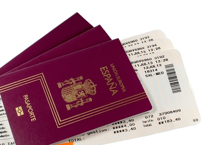 passports from Spain with airplane boarding pass isolated on white background  photo