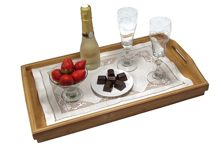 tray with champagne, strawberries and chocolates for two photo