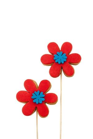 grasas saturadas: piruletas fondant galletas cubiertas adornadas con flores de azúcar forman Foto de archivo