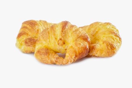 three freshly baked croissant isolated on white background