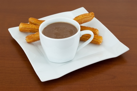 hot Chocolate with a Plate of deliciuos spanish Churros photo