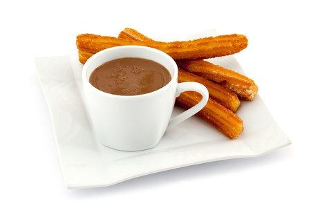 a Plate of deliciuos spanish Churros with hot chocolate isolated on white background