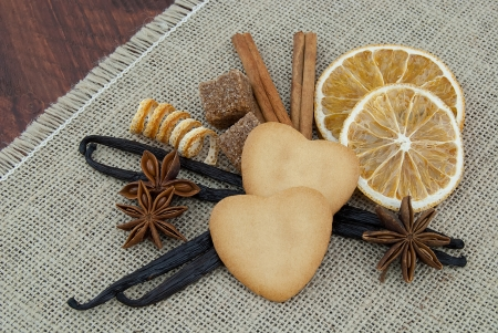 heart shaped cookie, orange,  cinnamon, star anise and vanilla  Brown and orange natural xmas Stock Photo - 20415487