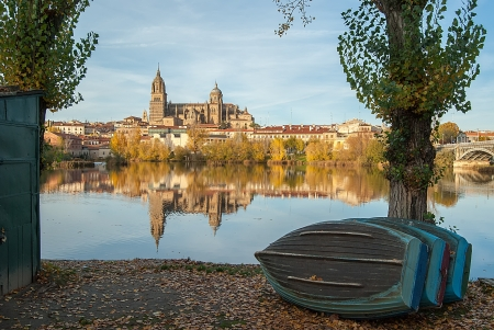 castilla: Salamanca Cathedral Reflected in the Rio Tormes sunlit fall and the boats on the shore