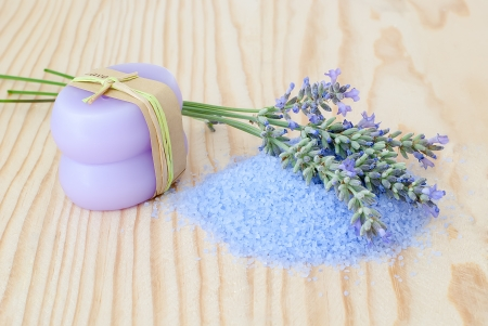 lavender bath salt,lavender flowers ,and candle on wooden table photo