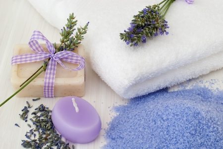 Spa resort therapy composition - lavander flowers, candle and salt crystals  photo