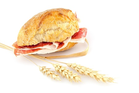 Typical spanish sandwich made with cured ham and  bread   photo
