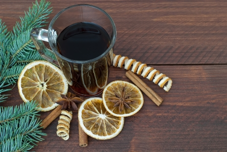 Hot drink with Christmas decoration on wooden rustic table photo