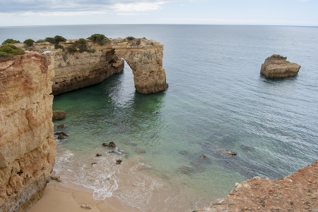 littoral: Exploring caves in cliff in littoral of Carvoeiro, Algarve  Portugal   Stock Photo