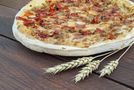 Delicious italian pizza served on wooden rustic table  photo