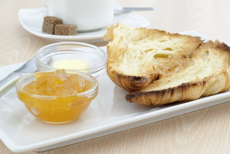 delicious breakfast  coffee with Croissant ,apricot jam and butter photo