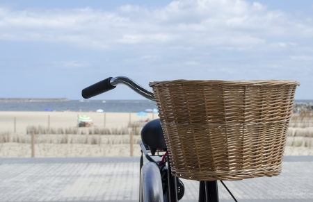 granny bicycle was found leaning against the railing overlooking the dunes, beach and cantabrian Sea