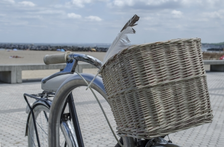 cantabrian: granny bicycle was found leaning against the railing overlooking the dunes, beach and cantabrian Sea