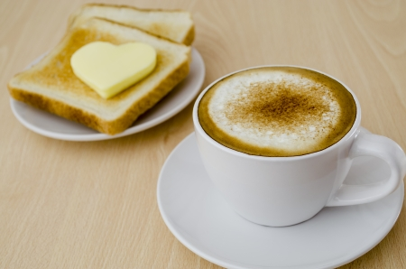 toast with apricot jam and cup of cappuccino for breakfast photo
