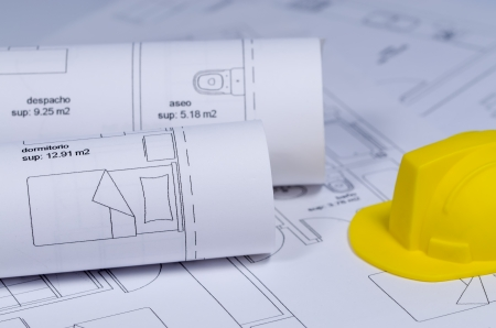 Construction plans  and yellow Hard Hat