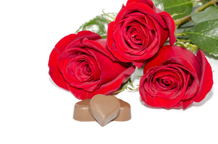 three chocolates  in the form of heart   photo