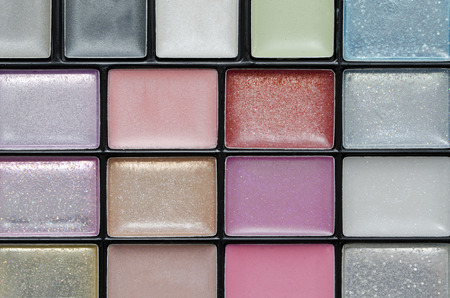 tight focus: Closeup on a case of eyeshadow with tight focus on the front color