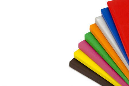 Multicolor Hardcover Book on white background photo