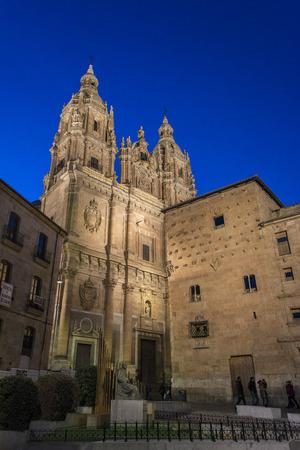 Casa de las Conchas and towers of the Clerecia illuminated at dusk, Salamanca, Spain