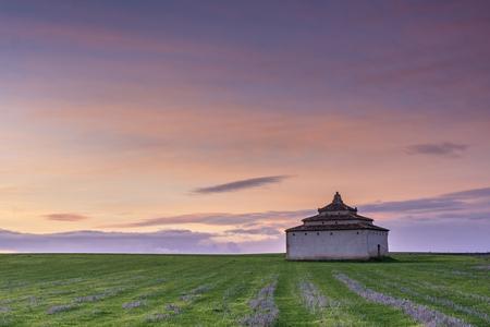 Dovecote built in stone at dusk, in Tierra de Campos, Castilla Spain