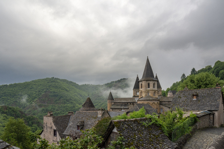Conques, Midi Pyrenees, France - June 12, 2015: View to Abbey of Saint-Foy at Conques, France